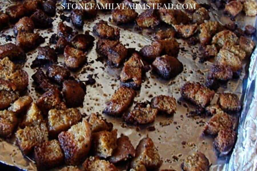 baked croutons on a cookie sheet - Perfect Homemade Croutons from Your Old Stale Bread - Stone Family Farmstead
