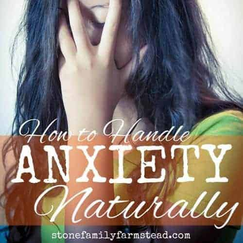 """woman with head in hands indicating anxiety with title """"how to handle anxiety naturally"""""""