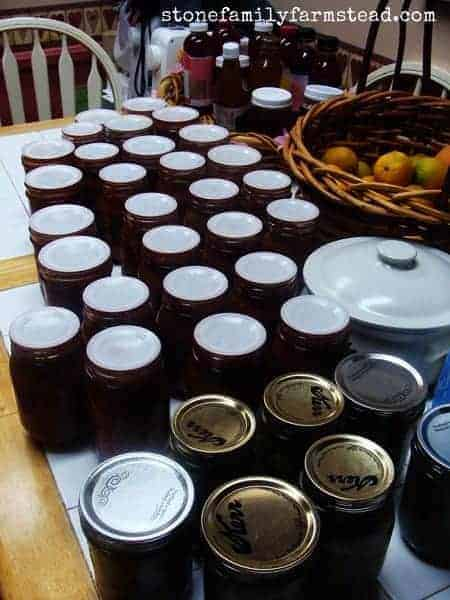 home canned food on a table - homestead management by Stone Family Farmstead