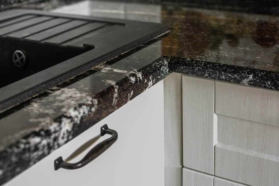 """close up of marble counter with the title """"Kitchen Design Ideas for the 21st Century Homesteader - Stone Family Farmstead"""""""